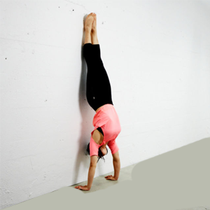 girl performing head stand